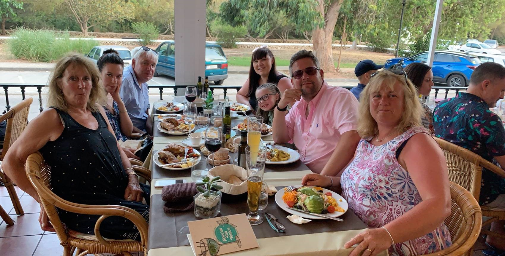 Jonny and his family enjoying a meal out in Menorca
