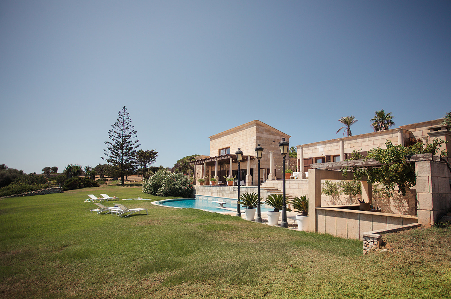 Exclusive and secluded cliff top villa in menorca with staff and wall to wall sea views